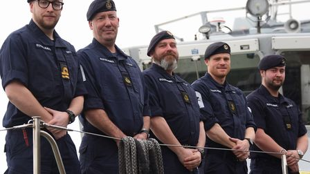 The crew line up on the Royal Navy patrol boat, HMS Biter, moored at King's Lynn's South Quay. From