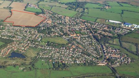 An aerial image of Reydon, with the development site highlighted in red. Picture: Mike Page