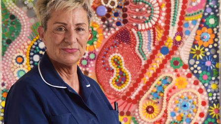 Midwife Cruella Jones with her artwork entitled Life Through Intervention created using discarded me