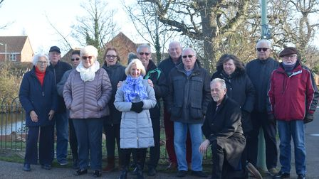 More than fifteen neighbours met at the pond in protest of its current state. Photo: Matthew Nixon