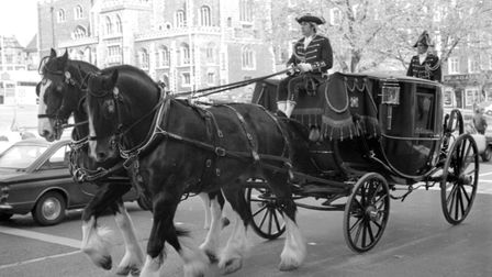 Shire Horses pull the civic coach carrying Sheriff of Norwich, Joe Stirling in 1976. Picture: EN Lib