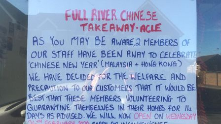 The sign in the window at Full River in Acle advising customers the takeaway will be shut until Febr