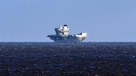 The 65,000-tonne warship, HMS Queen Elizabeth, and two frigates have been visible off the coast of L