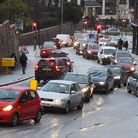 Cars struggling to get up Cattle Market Street in Norwich after a hail storm in the city on Monday P