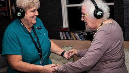Carers and residents at St John's House Care Home, Norwich, dance at a silent disco. Photo: Fiona Ma