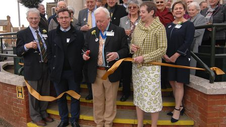 West Norfolk historian Dr Paul Richards performs the ribbon cutting at the official opening of Hunst