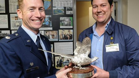 Lieut Col Kelly was presented with a replica of the silver pheasant given to the American air force