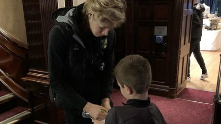 Luca Smith gets an autograph from Norwich City midfielder Todd Cantwell. Picture: Steve Smith.