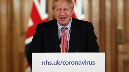 Prime Minister Boris Johnson speaking at a news conference inside 10 Downing Street, London, after t