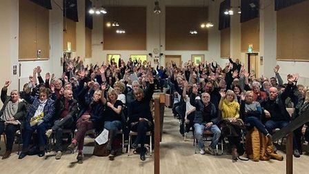 During a parish meeting at Connaught Hall, the room voted unanimously barring one abstention for a p