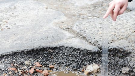 Huge pot holes have worsened in the road of the main entrance to the Cherry Tree car park in Dereham