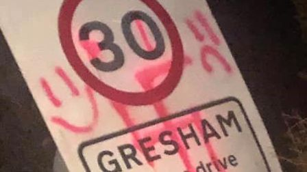 Graffiti, including the swastika, has been painted on signs and roads around the village of Gresham