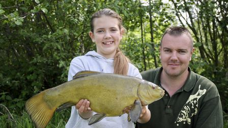 Memories are made of this... Heidi and Matt with a super tench Picture: John Bailey