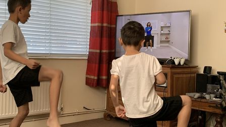 Rhys Edmonds, 10, and Nathan Edmonds, 5, take part in Joe Wicks PE exercises on YouTube. Picture: El