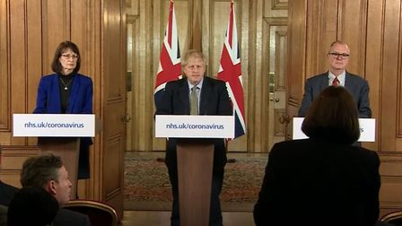 Video screen-grab of Dr Jenny Harries, Prime Minister Boris Johnson and Chief Scientific Adviser Sir