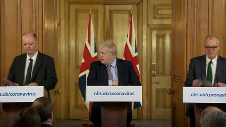 A screen-grab of prime minister Boris Johnson (centre) speaking at a media briefing in Downing Stree