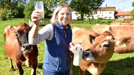 Rebecca Mayhew with some of her dairy cows at Old Hall Farm in Woodton. Picture: Nick Butcher