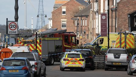 Police, firefighters, ambulances and coastguard seal off South Quay in King's Lynn. Picture: Chris