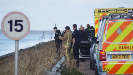 Emergency services on Crossbank Road, opposite the stretch of river where the body was found Pictur