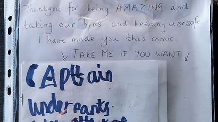 A note left to bin men by residents thanking them for their work during the coronavirus lockdown. Pi