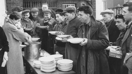Floods 1953Food rations handed out during the 1953 floods.Dated 8 February 1953Photograph C10443FO