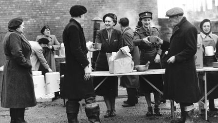 Floods 1953 - Kings LynnYoung and old alike queue for a drink as supplies of fresh water are broug