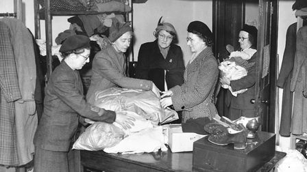 Floods 1953 - No IdentificationWomen sorting out parcels of clothing during the floods of 1953.Dat