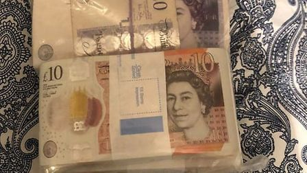 Cash seized by police following police raids in London connected to county lines drugs line in Norwi