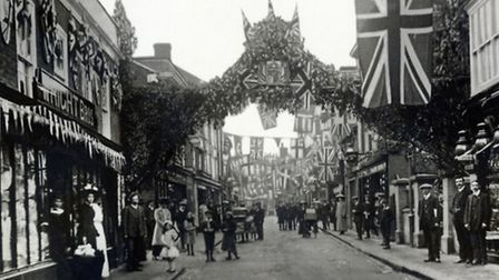 Masses of decorations on Dereham High Street for George V's coronation.