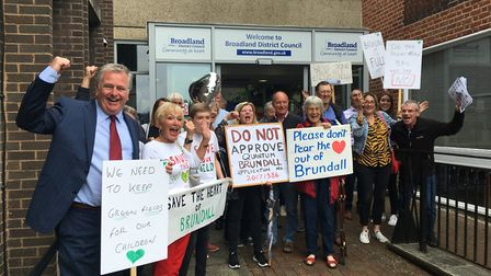 Delighted Brundall villagers celebrate after plans for 170 homes were rejected. This decision is now