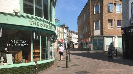 Just a handful of shoppers and cyclists on London Street in Norwich. Picture: Simon Parkin