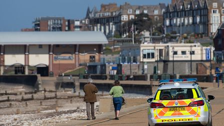 Police patrol the promenade at Hunstanton beach in Norfolk on Sunday, as the UK continues in lockdow
