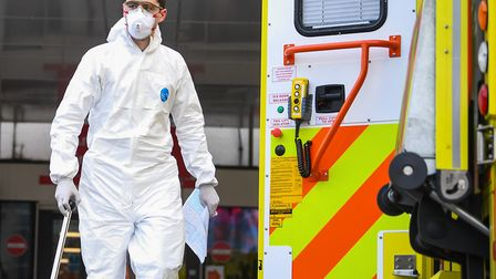 A paramedic wearing personal protective equipment (PPE)outside St Thomas' Hospital in Westminster, L