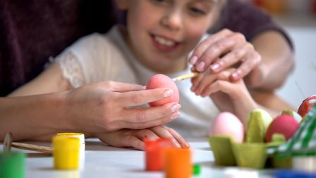 Decorating eggs. Picture: Getty Images/iStockphoto/Motortion