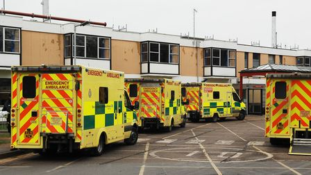 A man has been charged with causing criminal damage to an ambulance in the car park at Queen Elizabe
