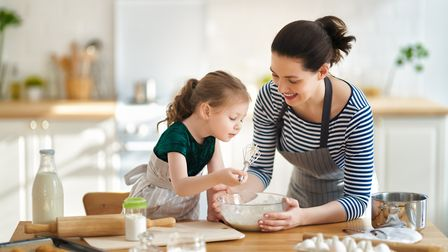 Bake with your children to keep them occupied over the holidays Picture: Getty Images/iStockphoto