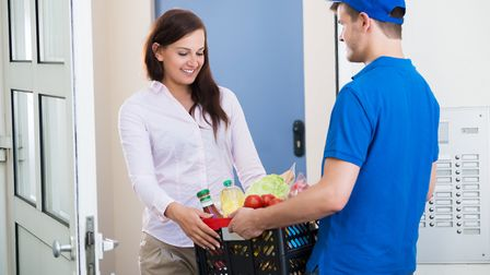 Woman receiving supermarket home delivery Picture: Getty Images/iStockphoto