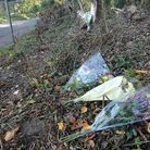 Flowers left at the scene of the crash, at Castle Rising Picture: Chris Bishop