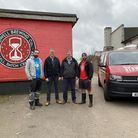 John Hughes, second from left and brother Paul, second from right, at Redwell Brewing. John Hughes s