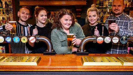Rose Hanison pictured with the team at The Black Horse, said the future was unclear until there was
