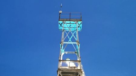 The drill tower at Hingham fire station has been illuminated with blue light in a show of respect to