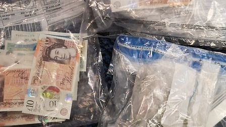 Cash and drugs seized by police in Thetford. Picture: Norfolk Police
