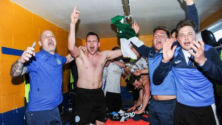 Celebrations in the King's Lynn Town dressing room Picture: Ian Burt