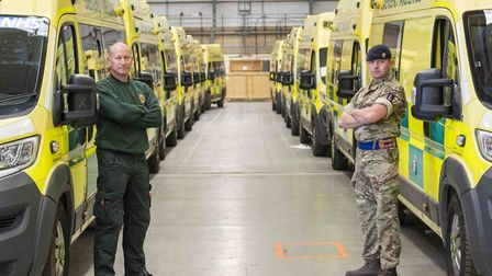 NHS Paramedic Dave Bacon (left) and Trooper Sam Jones (right) pose for an image representing the wor
