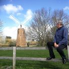 Alan Ferguson is the chair of Dereham Windmill Trustees and is pictured looking at the town's landma