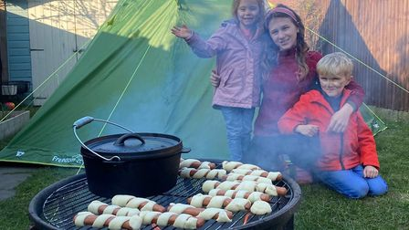 Daisy Heary, five, camping in the garden with mum, big sister Lilly and big brother Frank. Picture: