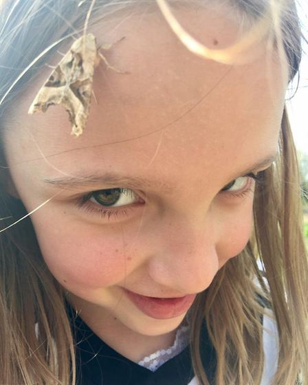 Juliet Bale, getting close to nautre when a butterfly land on her forehead. Picture: Adrian Bale