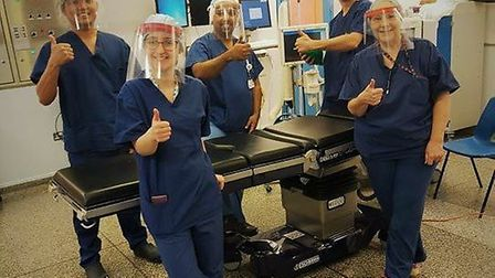 Staff at the Queen Elizabeth Hospital, King's Lynn using the PPE masks made by Fakenham Academy. Pic