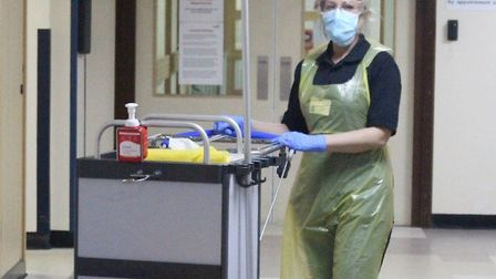 Cleaner Leanne Manning in protective clothing at the Queen Elizabeth Hospital in King's Lynn Pictur