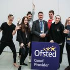 Stuart Rimmer, chief executive of East Coast College, and students. PICTURE: East Coast College